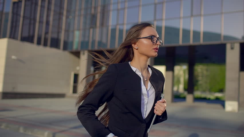 Businesswoman or female student in hurry busy, woman running late for work to meeting and looking at time. business education success girl students people. delay hurrying work meeting stress stressing | Shutterstock HD Video #1017270856