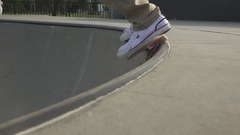 Skateboarder grinding on a halfpipe.