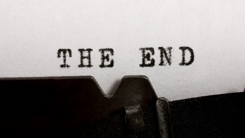 Typing THE END in black ink on an old mechanical typewriter. | Shutterstock HD Video #1017284386