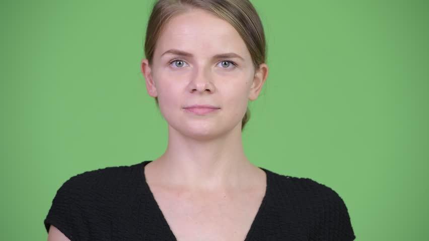 Head shot of young beautiful businesswoman   Shutterstock HD Video #1017335806
