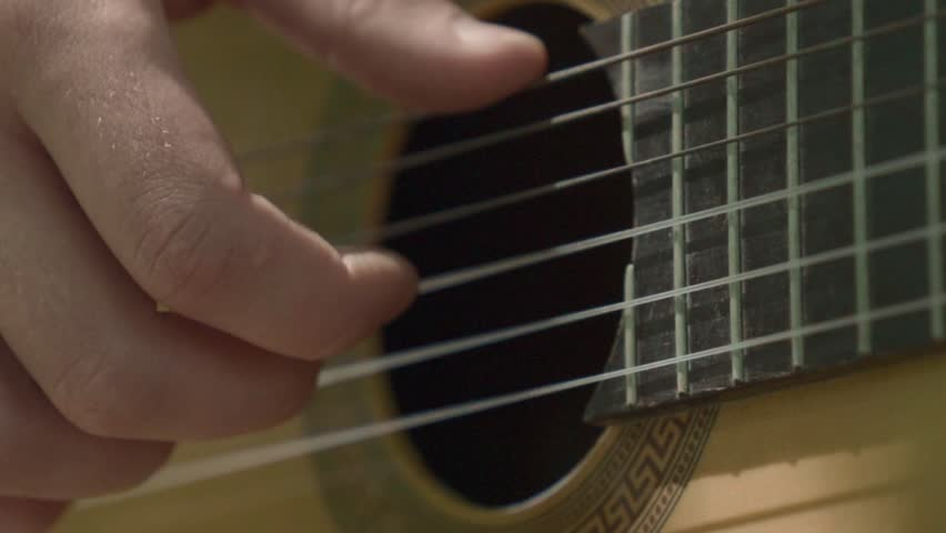 Human hand plays guitar slowly | Shutterstock HD Video #1017387976