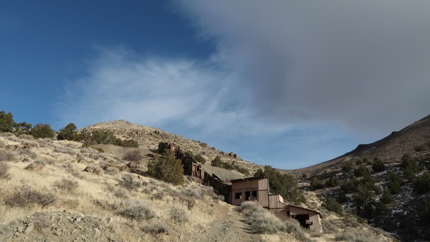 Time Lapse of clouds over abandoned mine in the Nevada Desert