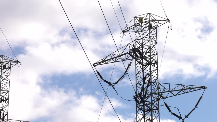 Large electric poles. High voltage. 4K, UHD, 50p, Cinematic,Closeup,    Shutterstock HD Video #1017406396