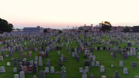 Beautiful dolly zoom in Brooklyn, NY grave yard at sunset