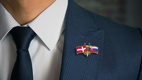 Businessman Walking Towards Camera With Friend Country Flags Pin Denmark - Slovakia
