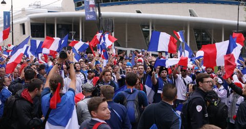 ST. PETERSBURG, RUSSIA - JULY 10, 2018: French football fans singing at Saint-Petersburg stadium before the semifinal match of FIFA World Cup 2018 France vs Belgium. France won 1-0