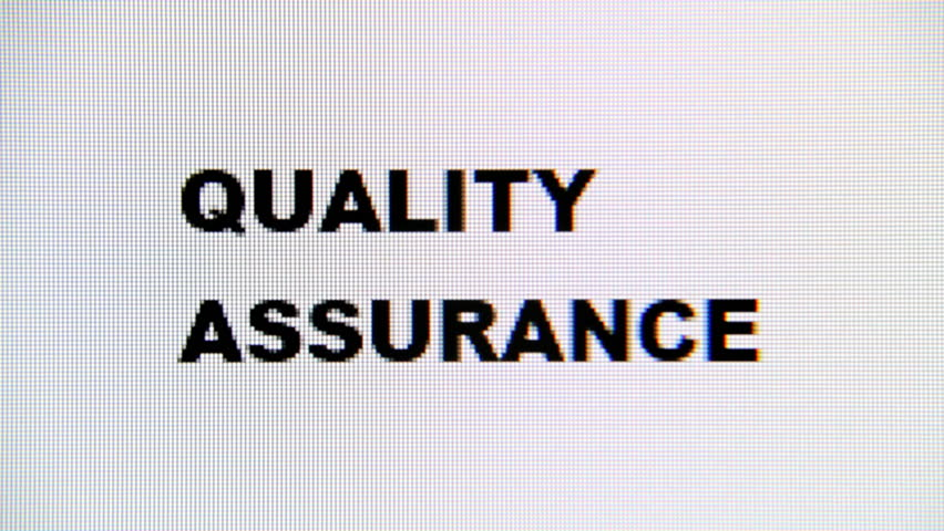 Typing the words Quality Assurance on a computer monitor. Macro detail shot.  | Shutterstock HD Video #1017516106