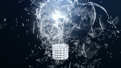 Explosion of an incandescent lamp or ligh bulb. Small pieces of glass fly apart in different directions. The effect of slowing down the time after the explosion. Problem solving concept.
