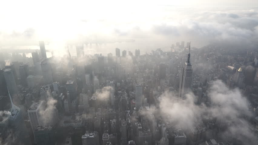 New York City Circa-2015, aerial view flying south over Midtown Manhattan at sunrise, facing the East River, with low level clouds | Shutterstock HD Video #1017520156