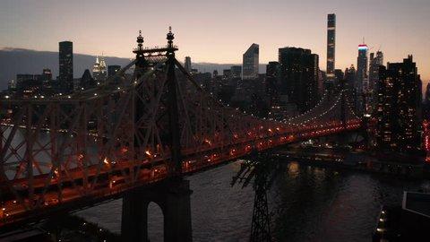 dusk flying along Queensboro Bridge towards Manhattan