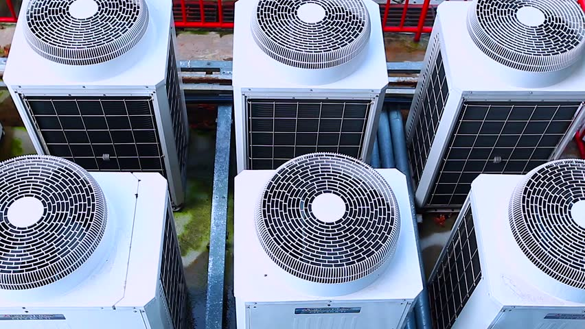 Row of Industrial large air conditioning fans on function | Shutterstock HD Video #1017572686