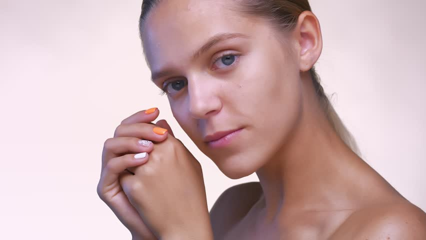 Perfect close-up skin and face of caucasian girl, looking at camera relaxed in white studio | Shutterstock HD Video #1017599776