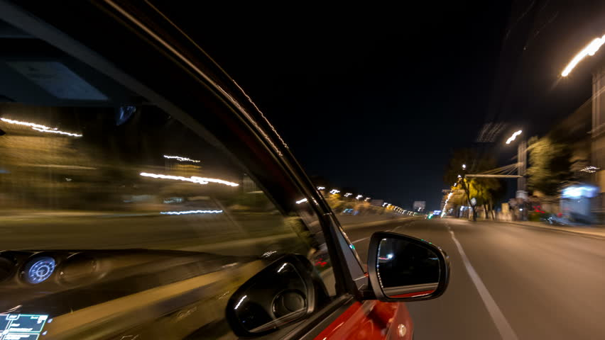 Drivelapse from side of fast car moving on a night avenue in city timelapse hyperlapse, road with lights reflected on car on high speed. Rapid rhythm of a modern city. | Shutterstock HD Video #1017607216