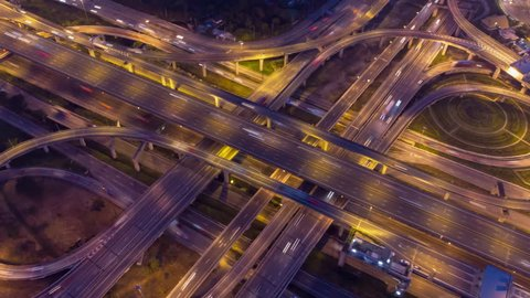 Aerial Hyperlapse of Traffic over big intersection bridges and ring road. 4K aerial view by a drone over big roundabout in Bangkok Thailand.