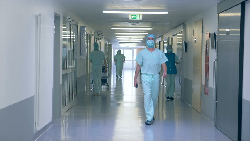 View of a hospital hall. Many people in a clinic hall, working. | Shutterstock HD Video #1017757156