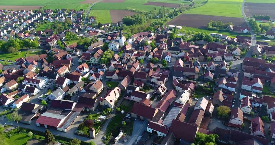 A little European city with a church in the center, European architecture, European village | Shutterstock HD Video #1017794866