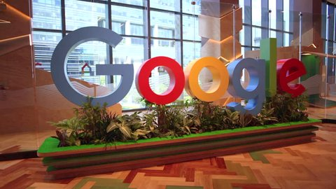 Singapore - May 5, 2018: Google logo inside the new offices of Google Headquarters in Mapletree Business City II, Singapore. Google's Asia-Pacific HQ.