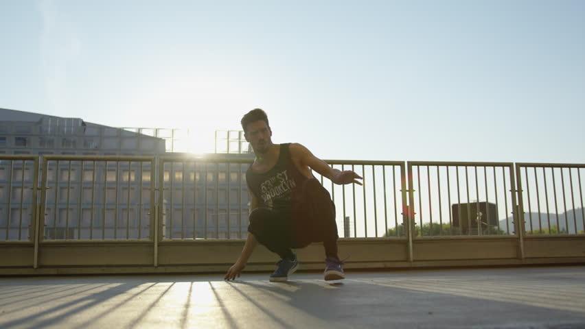 Breakdancer performing outdoors. #1017910816