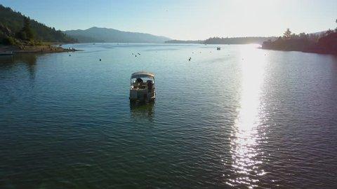 Early Morning Lake Fishing Pontoon Boat Fisherman Cast Aerial