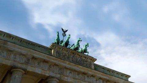 Quadriga of Brandenburg Gate (Brandenburger Tor) on Pariser Platz in Berlin, Germany. Time Lapse In Motion. Hyper Lapse. 4K