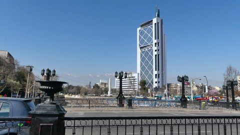 SANTIAGO, CHILE - Sep 11 2018. View of the Telephone Tower (Movistar) from the Pio Nono bridge while traffic and pedestrians passes by. Obelisk visible near the Mapocho River and the Baquedano Plaza.