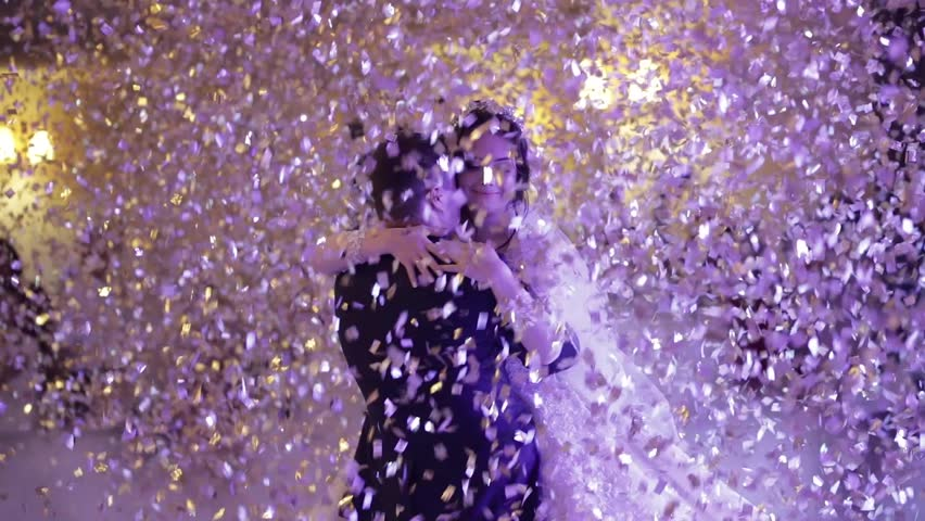 First dance of wedding pair in flying gold confetti. #1018036786