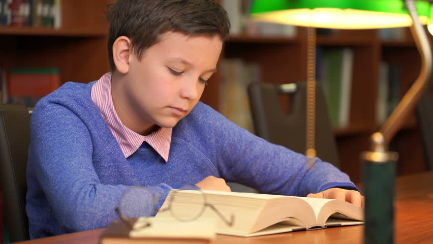 Footage portrait of schoolboy doing their homework and sleeping on the book. 4k education video | Shutterstock HD Video #1018037506