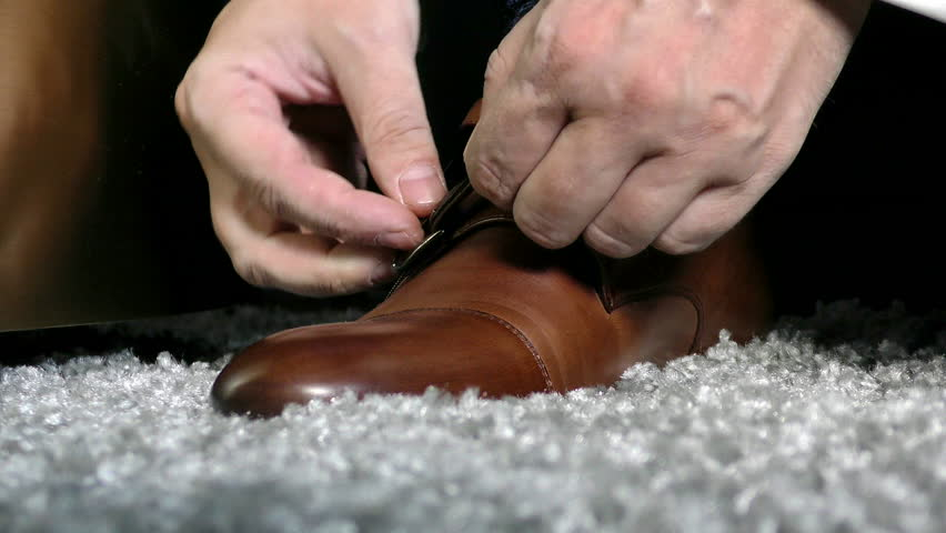 The gentleman wears brown leather shoes. Dress up man footwear on the way out.  #1018086976