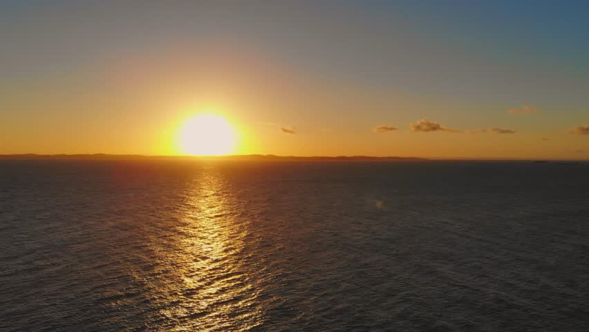 Sunset in the ocean from a high view. Aerial view | Shutterstock HD Video #1018113556