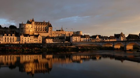 Amboise-France/Loire - October 10 2018 - The Royale d'Amboise castle reflecting in the Loire river at sunset - Motion view