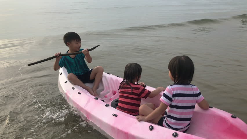 Happy family time and education for kids concept. Funny three asian children (3-6year) and grandfather playing in the water of summer activity outdoor with Kayak boat in the sea. | Shutterstock HD Video #1018389856