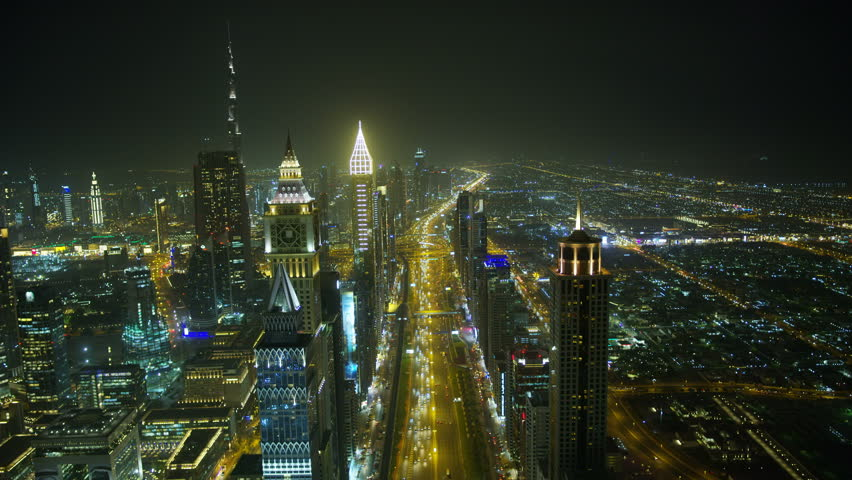 Dubai - March 2018: Aerial city night view of city skyscrapers Sheikh Zayed road Metro rail commuter vehicle transport highway UAE RED WEAPON | Shutterstock HD Video #1018439206