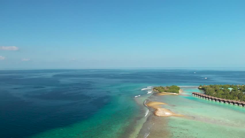 Aerial video of maldivian islands. Aerial view of tropical islands. Tropical Island Surf Waves | Shutterstock HD Video #1018612036