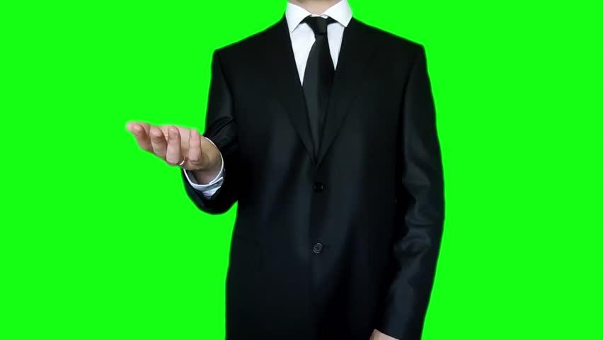 Man in black suit loosens tie on green screen… - Royalty