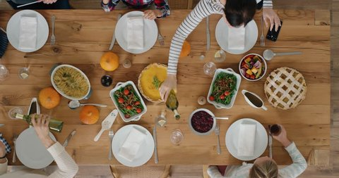 happy family preparing table enjoying delicious thanksgiving meal together tasty homemade lunch holiday celebration top view
