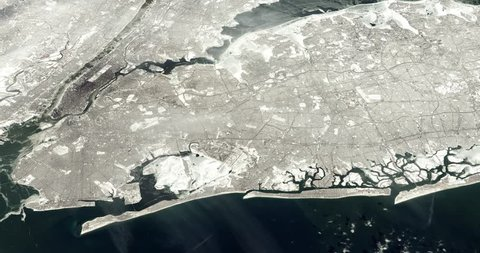 Very high-altitude circular tracking shot of a frozen New York City. Reversible, seamless loop. Elements of this image furnished by NASA