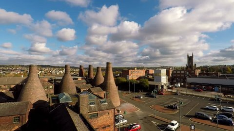 Aerial footage, view of the famous bottle kilns at Gladstone Pottery Museum in Stoke on Trent, Pottery manufacturing, industrial decline and vacant businesses Video 9 of 12