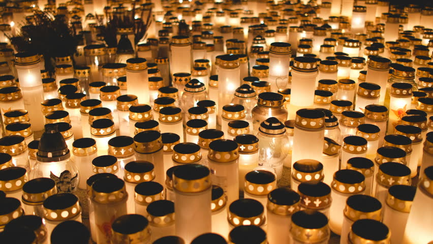 Many candles kindling at a cemetery on All Saints' Day   Shutterstock HD Video #1019036746