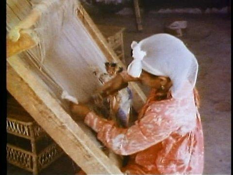 HARRANIA, EGYPT, 1977, Harrania Weaving Center, girl weaves vertical loom