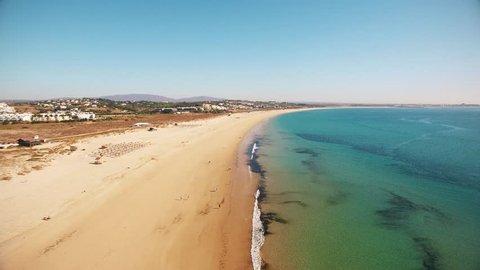 Aerial view of beautiful Meia Praia beach in Lagos, Algarve, Portugal at morning