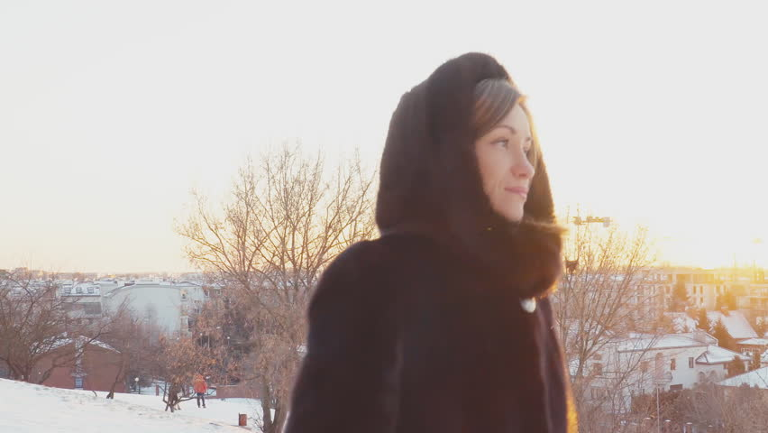 Young adult woman walking in the park outdoors in winter weather and looking at camera | Shutterstock HD Video #1019158246