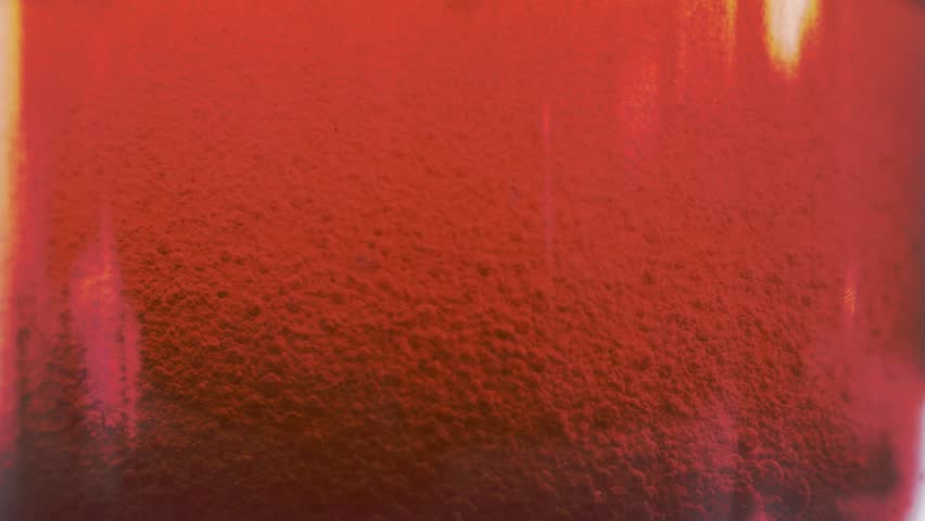 Red liquid with air bubbles #1019210536