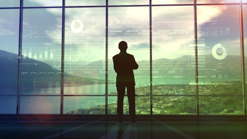 Businessman examines infographics data | Shutterstock HD Video #1019259136