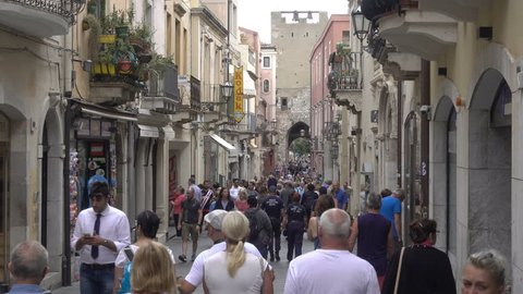 TAORMINA, SICILY/ITALY - SEPTEMBER 26, 2018: Unidentified tourists visit Taormina. Taormina in metropolitan Messina has been a tourist destination since the 19th century.