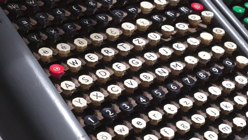 The old keyboard of the typewriter with the keys and letters on it | Shutterstock HD Video #1019340256
