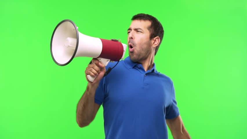 Man on green screen chroma key background holding a megaphone