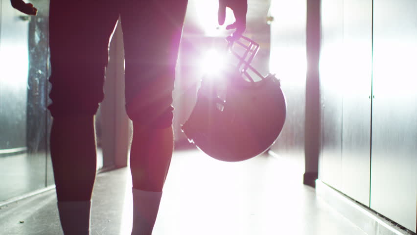 4K American football player walks alone through stadium tunnel before or after a game | Shutterstock Video #10194488