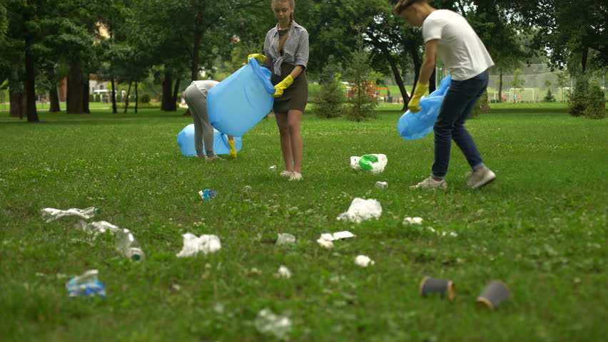 Active citizens collecting garbage in public park, society against pollution | Shutterstock HD Video #1019527966