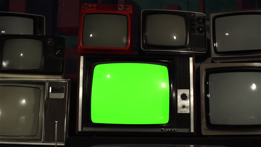 80s TV Green Screen with Many 80s Tvs. Dolly Out Fast.  Ready to Replace Green Screen With any Footage or Picture you Want.  | Shutterstock HD Video #1019612056