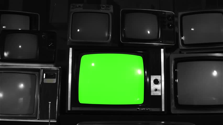 "Old TV Green Screen over 80s TVs. BW Tone. Dolly In Fast. You can Replace Green Screen with the Footage or Picture you Want with ""Keying"" effect in After Effects (check out tutorials on YouTube).  